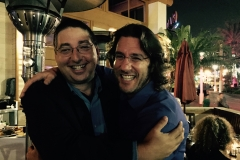 Lee Goldberg and Barry Eisler hug at Bouchercon 2014