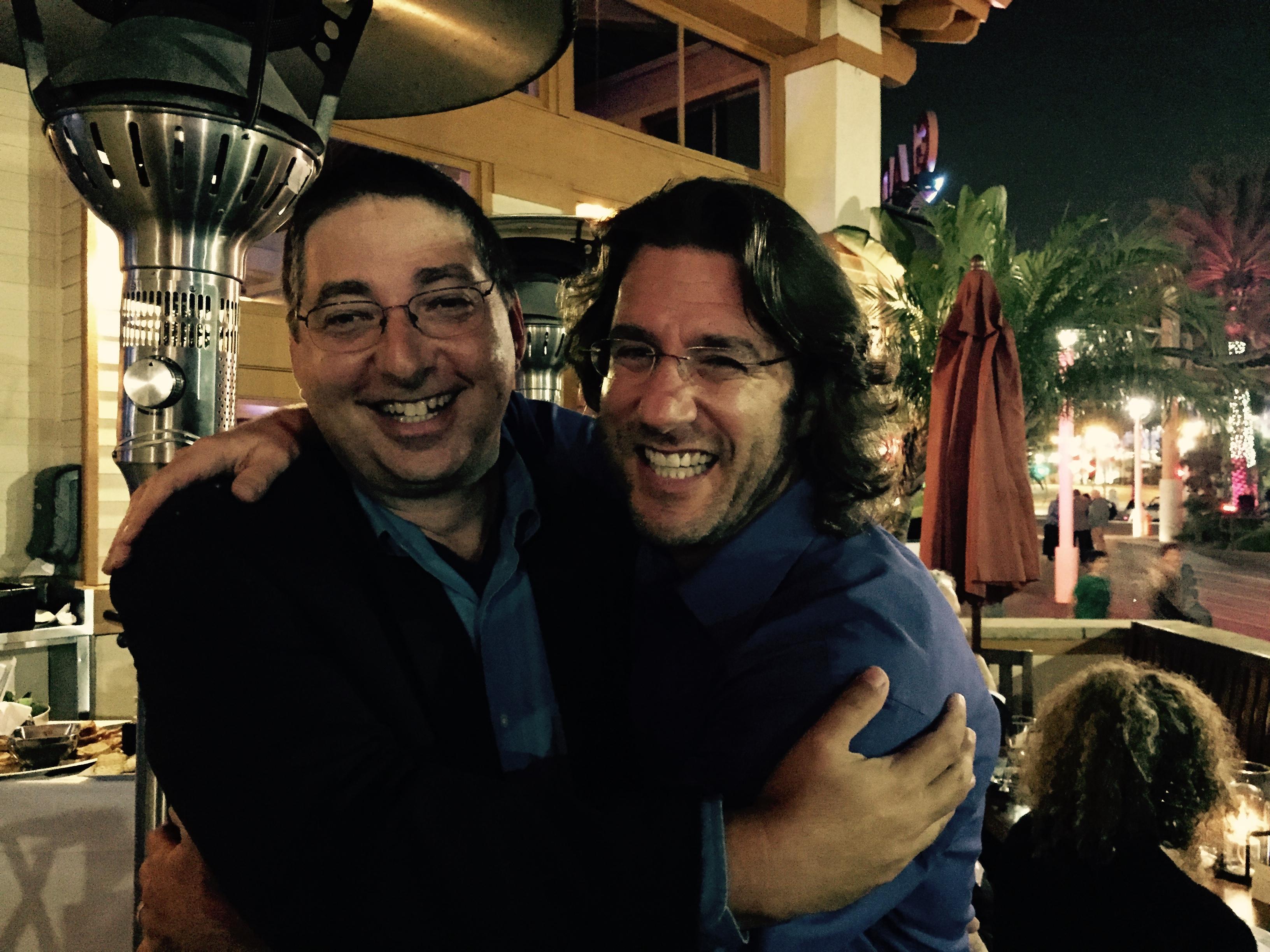 Lee Goldberg and Barry Eisler hug at Bouchercon 2014